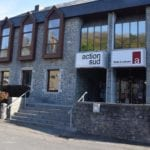 Image du bâtiment avec les logo Action Sud